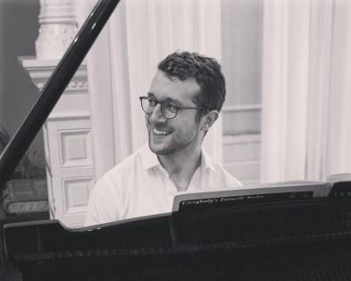Chad Goodman at Piano Smiling